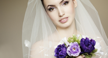 Portrait of a fresh and lovely bride with flowers bouquet